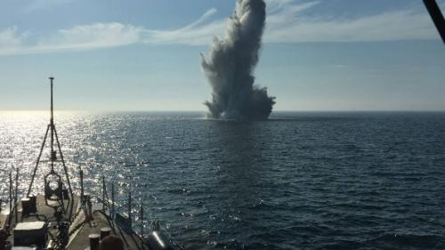 Explosion of a mine coordinated from a minehunter